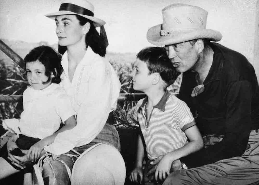 Huston is seen here with his wife Ricki Soma, daughter Angelica and son Tony (possibly during the filming of Heaven Knows, Mr. Allison). Photo by The Print Collector/Print Collector/Getty Images.
