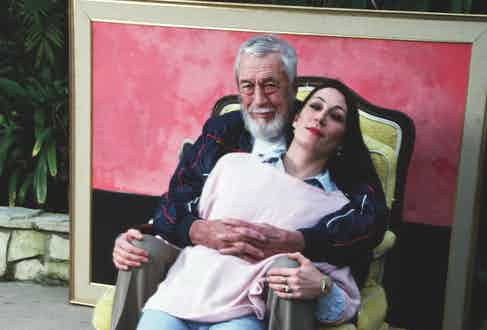 Anjelica Huston and her father, John Huston, sit together for an affectionate portrait, 1985. Image by © Marianne Haas/CORBIS.