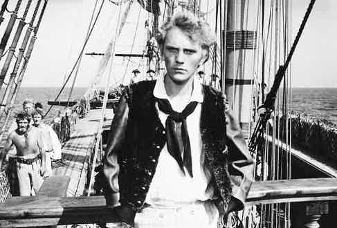 Terence Stamp, British actor, in period costume on the deck of a ship, in a publicity portrait issued for the film, 'Billy Budd'. Photo by Silver Screen Collection/Getty Images.