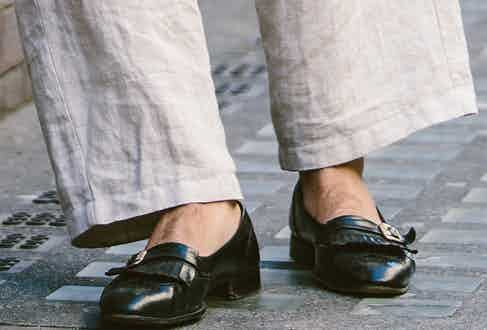 """Reluctant to give away his source (and who could blame him?), Adam's 1950's Bally slip-on loafers are a thing of beauty; their polished black leather, fringe detailing and buckles, adds an old-school sense of sophistication to his outfit. """"My instinct for clothes comes from shopping at a young age – it's all about seeing and being around people in the industry, and I've always been curious. 'What shoe style is that? What's that collar name? What's that cut?'"""""""