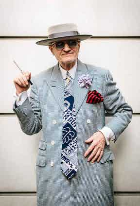 """""""It's a dress coat – the kind of thing you'd wear in the living room in the Edwardian period after you'd been out to the House of Commons, you know – with a glass of sherry!"""" A regular patron of Soho tailor Mark Powell, he and George have a mutual understanding. """"Fortunately for me, we get on; he knows what I want, we speak the same language."""" His latest zoot suit by Powell received much attention during fashion week, when he ended up with over 6000 hits on the New York Times website."""