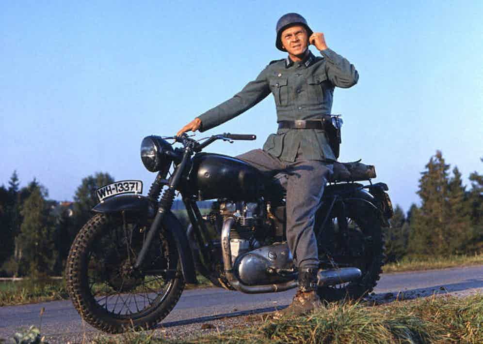 Steve McQueen wearing a German military uniform, sitting astride a motorcycle in a publicity still issued for the film, 'The Great Escape', 1963. starred McQueen as 'Captain Virgil 'The Cooler King' Hilts'. Photo by Silver Screen Collection/Getty Images.