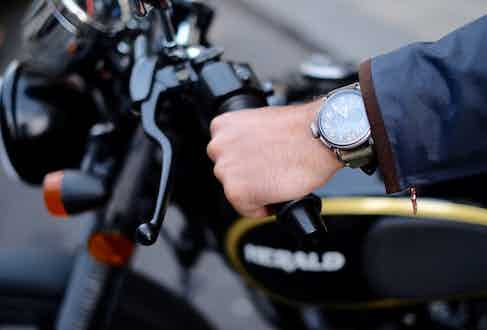 A Zenith Pilot Ton Up watch worn astride a Herald Classic 125. Photograph by Justin Hast.