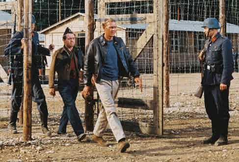 McQueen being marched through a gate by German guards in a publicity still issued for the film, 'The Great Escape', 1963. Photo by Silver Screen Collection/Getty Images.