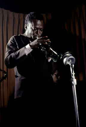 American jazz musician Miles Davis playing the trumpet, New York, 1958. Photo by Robert W. Kelley/The LIFE Picture Collection/Getty Images.