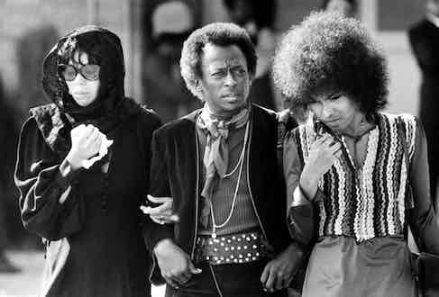 Jazz trumpeter Miles Davis with his wife Betty Mabry and an unidentified woman arriving at the funeral of rock guitarist Jimi Hendrix.  Photo by Bob Peterson/The LIFE Images Collection/Getty Images.