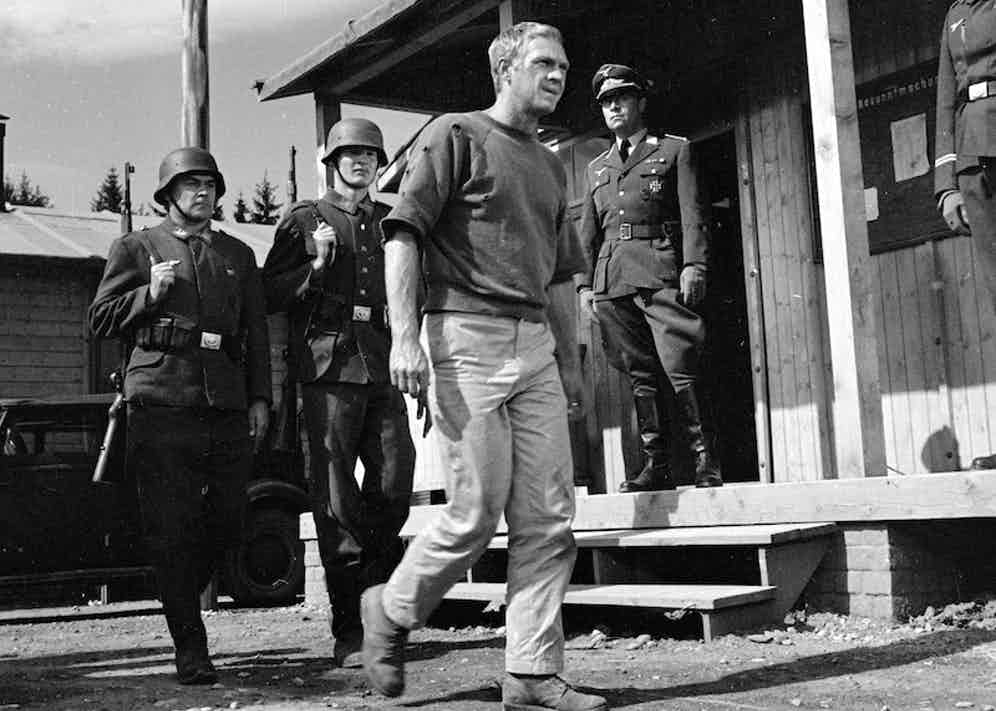 Steve McQueen as Captain Virgil Hilts and Robert Freitag, as Hauptmann Posen, in 'The Great Escape', directed by John Sturges, 1963. Photo by Silver Screen Collection/Getty Images.