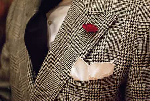Perhaps the most delicate touch to his look, he insists it's only a moment — no gardens in your lapel!