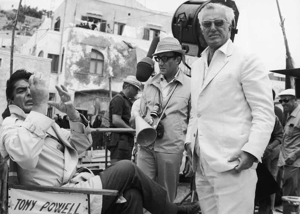 From left to right, actors Victor Mature and Peter Sellers, and Italian director Vittorio de Sica on Ischia, during the filming of 'Caccia alla Volpe' ('After the Fox'), 1965. Mature sits on a chair bearing the name of his character, Tony Powell. Photo by Keystone/Hulton Archive/Getty Images.