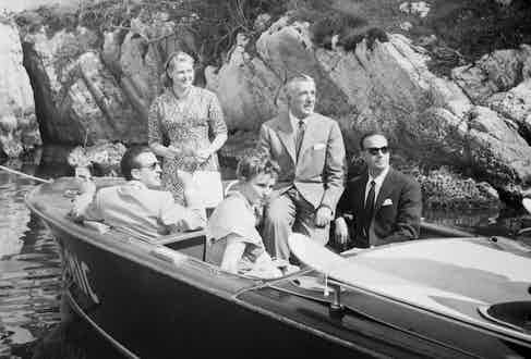 Actress Ingrid Bergman with Cannes Film Festival director general Robert Favre Le Bret and directors Vittorio De Sica and Roberto Rossellini during speedboat tour to the Lerins Islands in the bay of Cannes in May 1956 in Cannes, France.