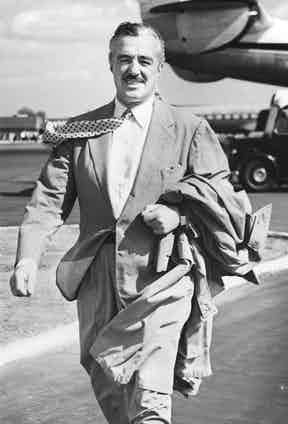 Italian actor and director Vittorio De Sica at London Airport, 1955. Image by © Hulton-Deutsch Collection/CORBIS.