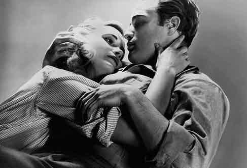 Marlon Brando and Eva Marie Saint on the set of 'On the Waterfront'. Photo by 20th Century-Fox/Getty Images.
