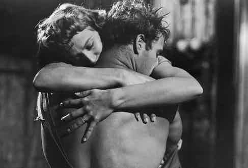 Kim Hunter and Marlon Brando embrace in a still from the film, 'A Streetcar Named Desire'. Photo by Warner Brothers/Getty Images.