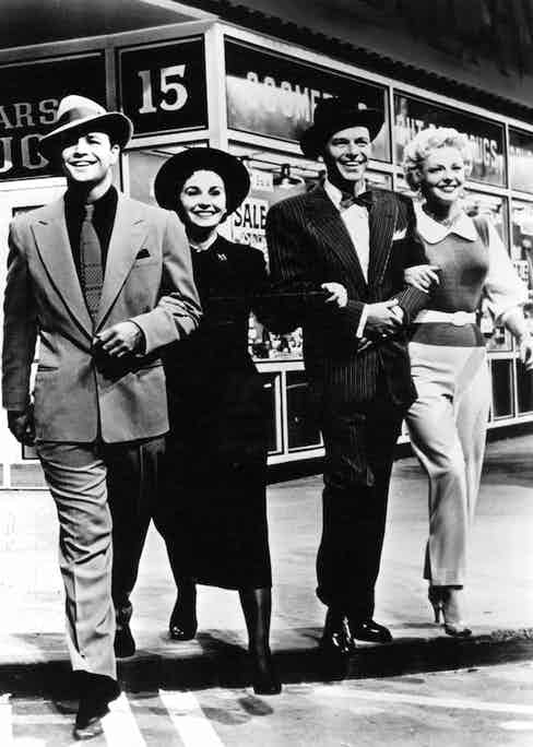 Marlon Brando, Jean Simmons, Frank sinatra and Vivian Blaine in a scene from the film 'Guys And Dolls', 1955. Photo by Metro-Goldwyn-Mayer/Getty Images.