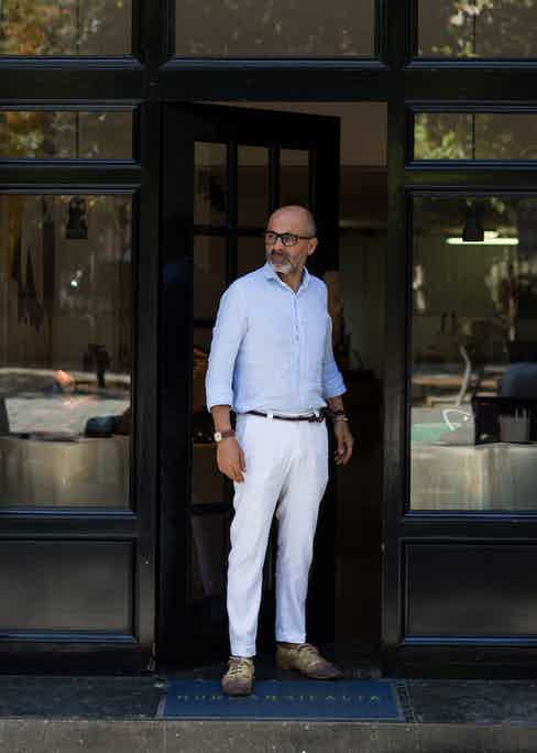 """""""The work of a shoemaker is very physical"""", says Norman, """"I tend to dress down day-to-day; a shirt and trousers underneath my apron. This shirt is bespoke, as are the trousers. I love the irregularity and drape of good linen."""""""