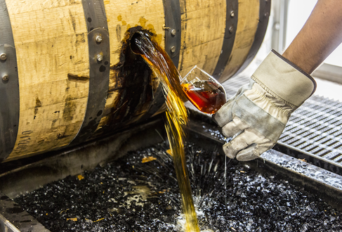 A Woodford Reserve worker samples one of their barrels, ready for bottling. (Images courtesy of Woodford Reserve)
