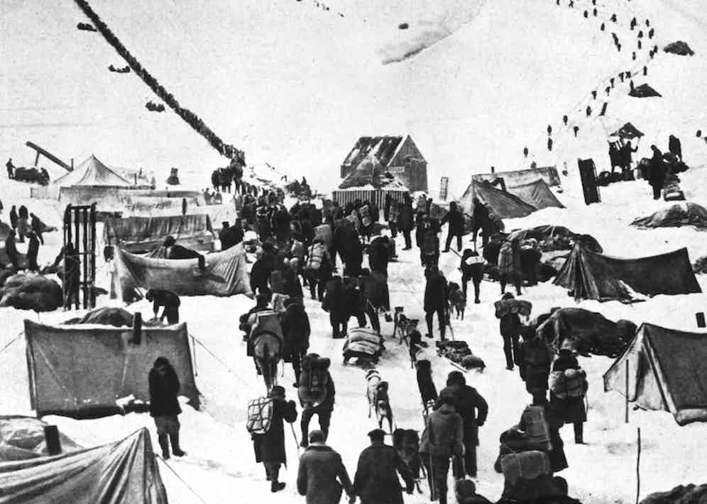 Circa 1895:  A caravan of prospectors arriving at the snowy wastes of the Klondike in Canada to join the great Gold Rush.  (Photo by Topical Press Agency/Getty Images)