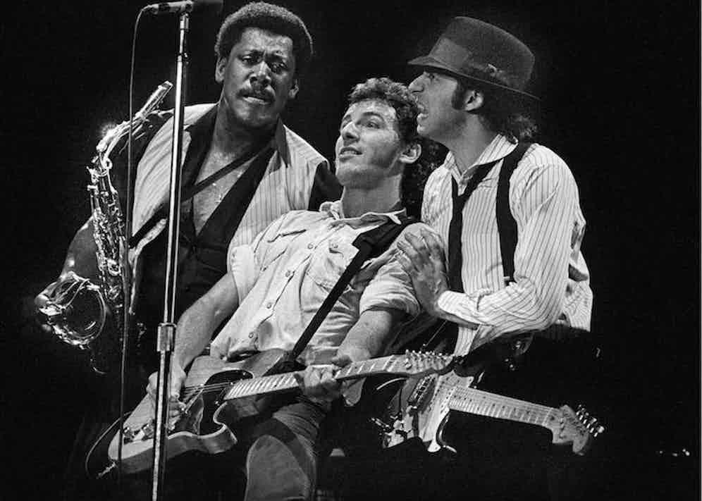 Clarence Clemons, Bruce Springsteen and Steven Van Zandt (aka Little Steven) performing live on stage. Photo by Rob Verhorst/Redferns.