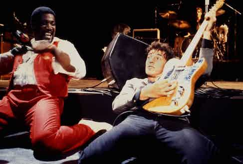 Clarence Clemons and Bruce Springsteen, with Clarence Clemons - E-Street Band, performing live onstage at Muse 'No Nukes' Benefit, Madison Square Garden. Photo by Richard E. Aaron/Redferns.