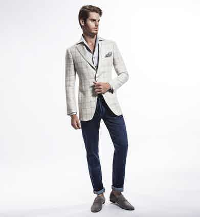 Ecru Single-Breasted Linen Jacket, Grey Button-Down Linen Shirt, Blue Cotton Jeans, Grey Suede Penny Loafers; all Cifonelli for TheRake.com.
