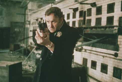 Gene Hackman as Detective Jimmy 'Popeye' Doyle points his handgun in a still from the film 'The French Connection', 1971. Photo by 20th Century Fox/Getty Images.