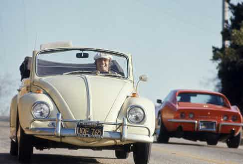 American actor Jack Nicholson laughs as he drives his white, convertible Volkswagon Beetle along an unidentified road, Los Angeles, California, September 4, 1969. Photo by Arthur Schatz/The LIFE Picture Collection/Getty Images.