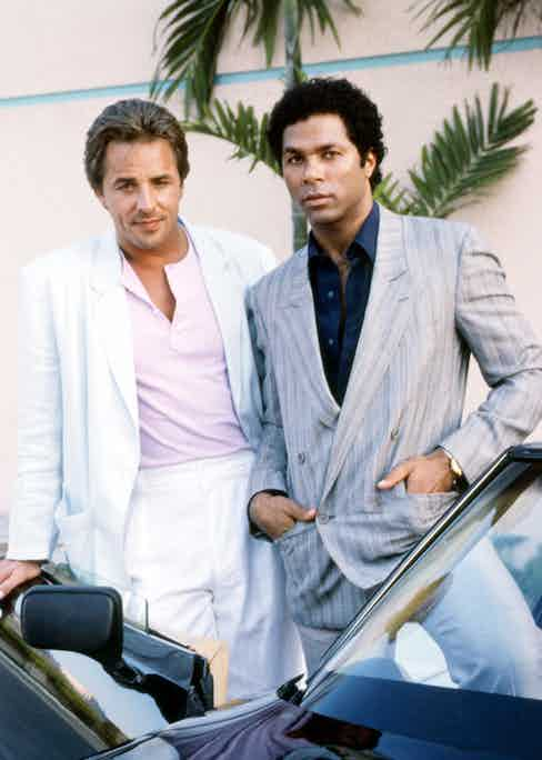 American actors Don Johnson and Philip Michael Thomas, as detectives James 'Sonny' Crockett and Ricardo Tubbs, in a promotional portrait for the TV series 'Miami Vice', circa 1985. Photo by Silver Screen Collection/Getty Images.