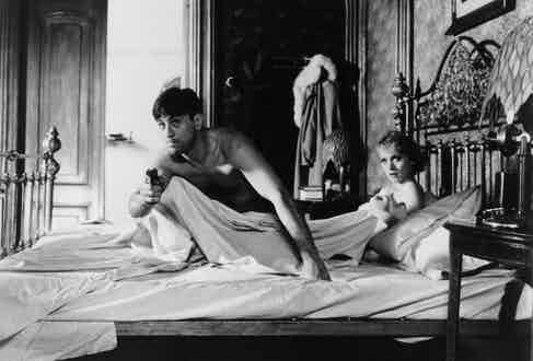 Actor Robert De Niro stars as Noodles with Darlanne Fluegel as Eve in the film 'Once Upon a Time in America', 1984. Photo by Warner Bros./Getty Images.