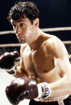 American actor Robert De Niro as Jake LaMotta in a fight scene from 'Raging Bull', directed by Martin Scorsese, 1980. Photo by Silver Screen Collection/Getty Images.