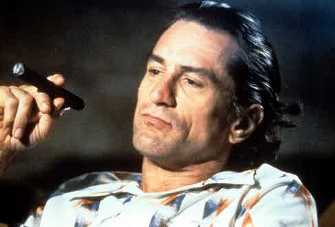 Robert De Niro smokes a cigar in a scene from the film  'Cape Fear', 1991. Photo by Universal/Getty Images.