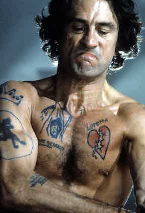 Robert De Niro shows off his tattoos in a scene from the film  'Cape Fear', 1991. Photo by Universal/Getty Images.
