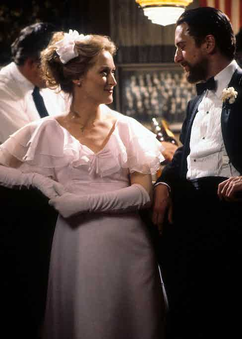 Meryl Streep smiling at Robert De Niro in a scene from the film 'The Deer Hunter', 1978. Photo by Universal/Getty Images.