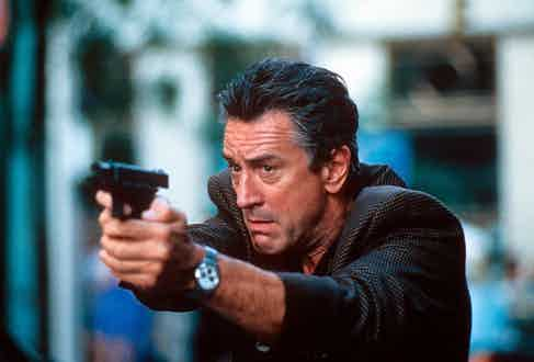 Robert De Niro aiming gun in a scene from the film '15 Minutes', 2001. Photo by New Line Cinema/Getty Images.