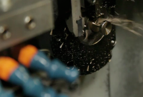 A cufflink from the Aerospace collection goes through the precision turning stage.