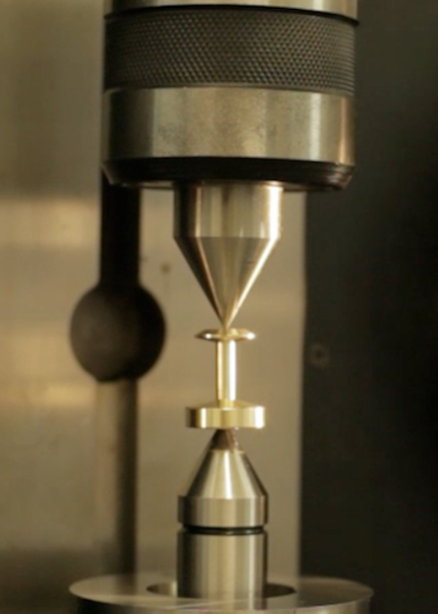A cufflink from the Aerospace collection is measured up.