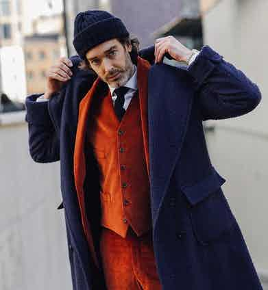 Richard Biedul contrasts his exclusive navy Rubinacci x The Rake Casentino coat with a vibrant corduroy suit.