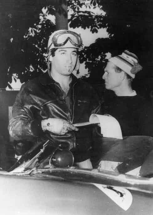 Racing driver Marquis de Portago and on the right Peter Collins before the start of the Mille Miglia Road Race when the tyre on the Marquis's Ferrari burst causing a crash which killed him, his co-driver and twelve spectators, 1957. Photo by Keystone/Getty Images.