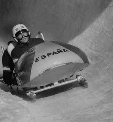Spanish Sportsman, Alfonso De Marquis Portago, racing bobsled down icy course at fast clip during Winter Olympics. Photo by George Silk/The LIFE Picture Collection/Getty Images.