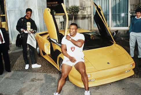 Mike Tyson and his Lamborghini. Photo by Sipa Press/REX/Shutterstock.