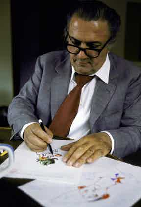 In his studio at Rome's Cinecitta movie center Director Federico Fellini draws endless faces and costumes sketches for the motion picture The Clowns.  Photo by Carlo Bavagnoli/The LIFE Picture Collection/Getty Images.