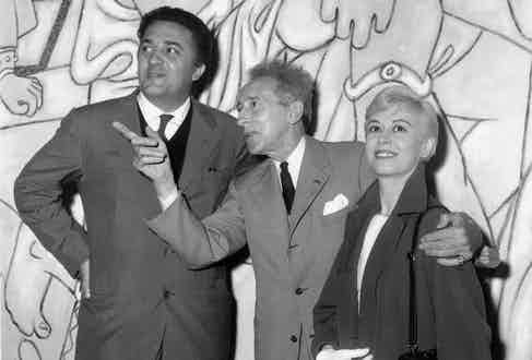 Federico Fellini and Giulietta Masina visiting the Saint Peter chapel decorated by Jean Cocteau, 1957 in Villefranche sur mer, France during Cannes film festival.