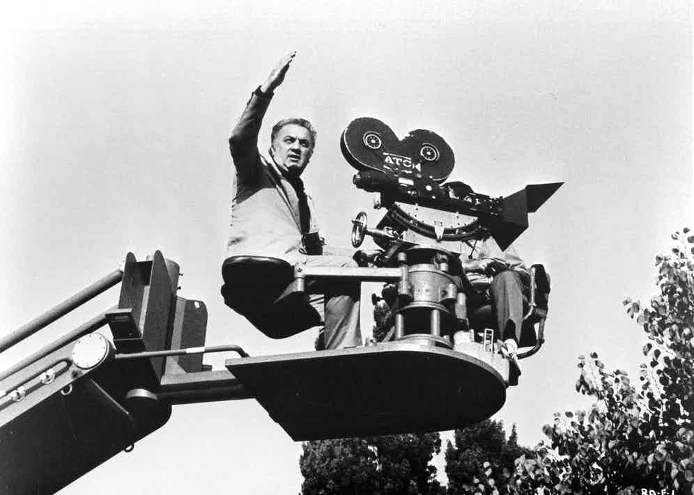 """Director Federico Fellini behind the scenes of the United Artist movie """"Fellini's Roma"""" in 1972. Photo by Michael Ochs Archives/Getty Images."""