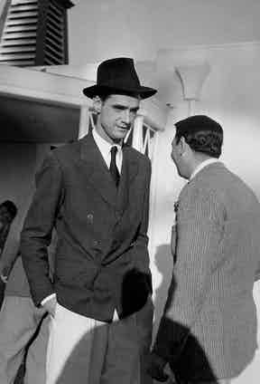 Howard Hughes (L) arriving at Arrowhead Springs Hotel. Photo by Herbert Gehr/The LIFE Images Collection/Getty Images.