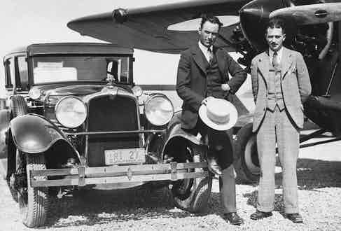 =Howard Hughes and stunt flyer Roscoe Turner at an airport in California. Hughes is driving the official car of the Pacific Aero Club, 1928. Photo by Underwood Archives/UIG/REX/Shutterstock.