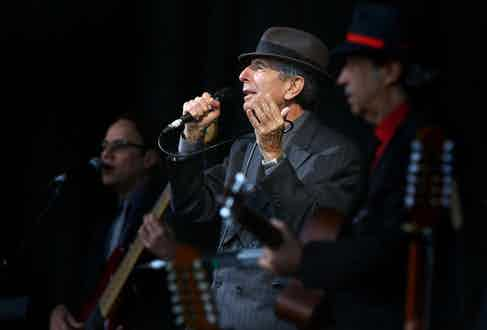 Canadian poet and singer Leonard Cohen performs at the Glastonbury Festival at Worthy Farm, Pilton in Glastonbury on June 29, 2008. AFP PHOTO/Ben Stansall/Getty Images.