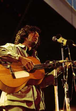 Photo of Leonard COHEN, performing live onstage at the Isle of Wight Festival.  Photo by Tony Russell/Redferns.