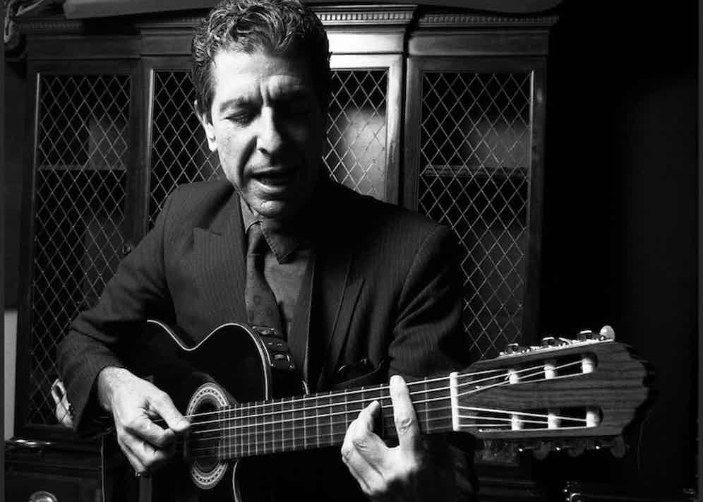 Leonard Cohen, Canadian poet and singer-songwriter, plays some of his songs in a small recording studio, lower Manhattan, New York, mid 1980s. Photo by Oliver Morris/Getty Images.