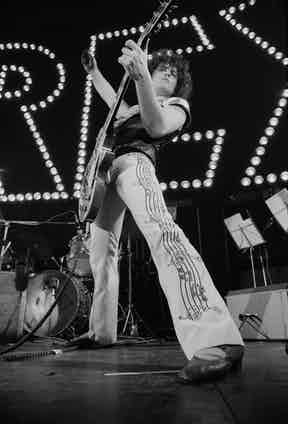 Marc Bolan performing with British glam rock group T-Rex, at The Apollo, Glasgow, 22nd January 1974. Photo by Michael Putland/Getty Images.