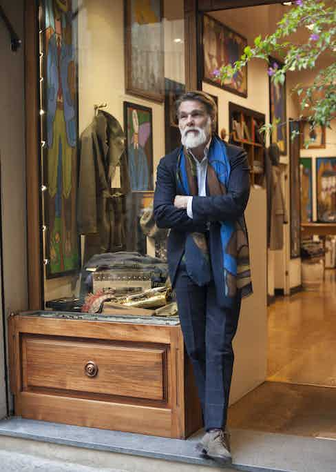 """""""The scarf is one of our products too, it's a prototype that I made just for me. I print my paintings on lightweight cashmere and silk."""" An artist as well as a tastemaker, the scarf injects a welcome boost of colour and character into his Prussian blue single-breasted suit."""