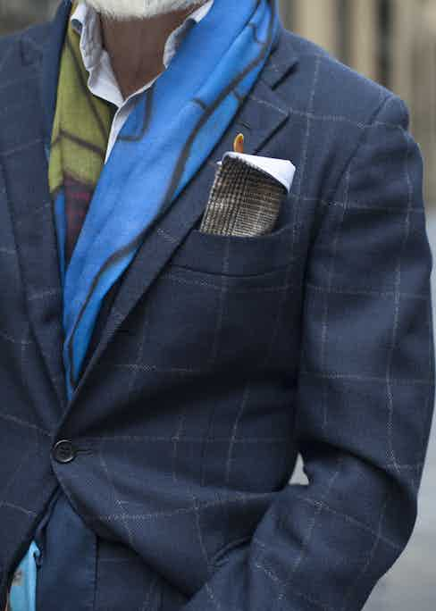 """""""My wife handmade this for me from one of our bunches, so it's got that personal touch."""" In place of a pocket square, Righi's glasses holder rather sweetly blends function with flair by way of his wife's sewing skills."""
